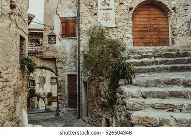 Old streets of italian medieval village of Tenno, Trentino Alto Adige