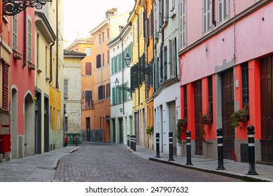 Old streets in Italian town with houses painted in different colors, Parma, Italy