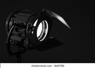 Old studio light on movie set with black background