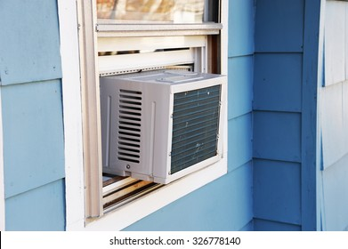 old style air conditioner installed on window