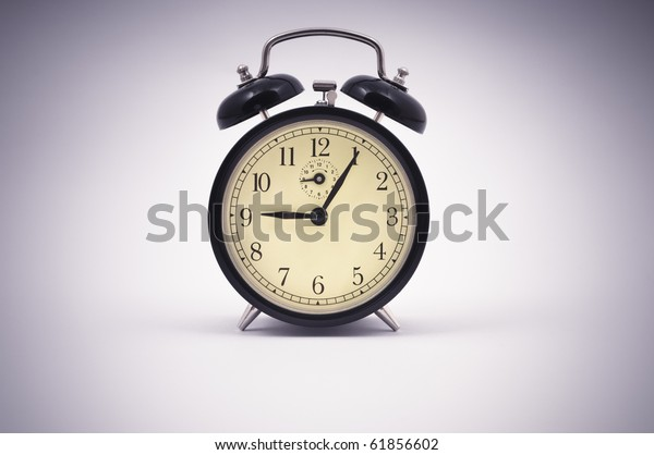 Old style alarm clock close up with vignette