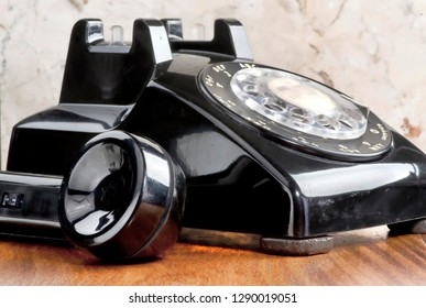 Old style black rotary telephone.