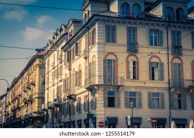 Old style buildings with balconies, windows and shutters in historical city centre of Turin Torino city, vintage photo, Piedmont, Italy