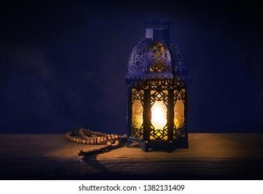An old style decorative Islamic lantern and rosary. Traditional Ramadan Lantern or Fanous.