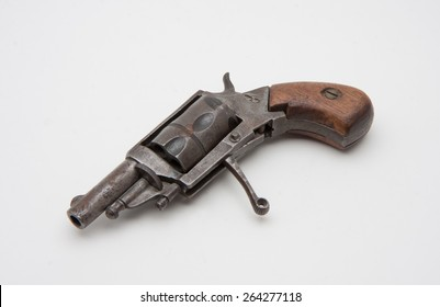old style derringer revolver rusted and damaged