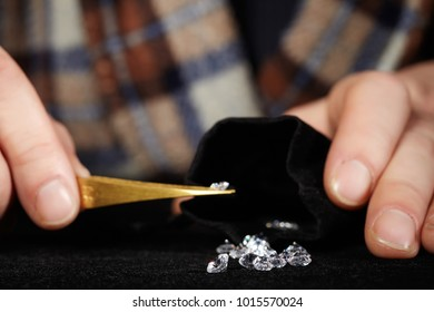 Old style diamond smuggler counting his goods