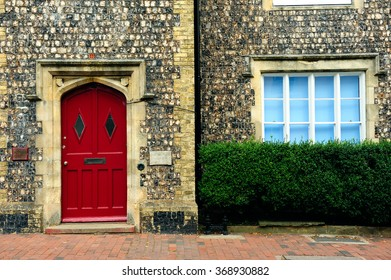 Old style English house with red door