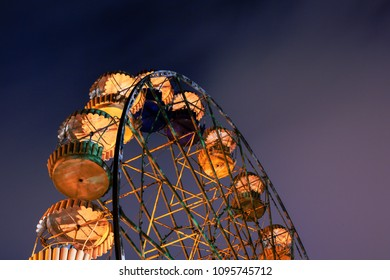 Old style Ferris wheel at the spring night