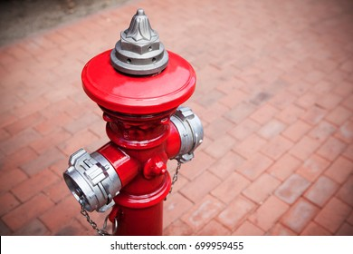 Old style fire hydrant in red color