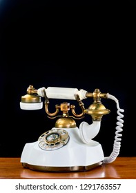 Old style French style rotary telephone with room for your type.