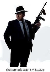 Old style gangster with machine gun, on white background