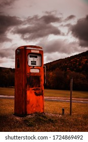 Old style gasoline pump with dark clouds and artificial colors