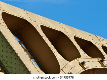 Old style Gold painted steel beam and girders in an abstract view of Sacramento Tower Bridge