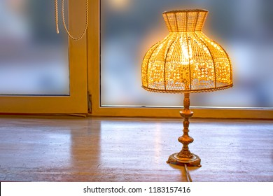 old style lamp. It's electric but looks awesome like some art object. its lampshade is hand made
