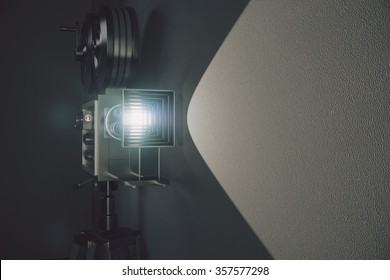 Old style movie camera at grey wall background