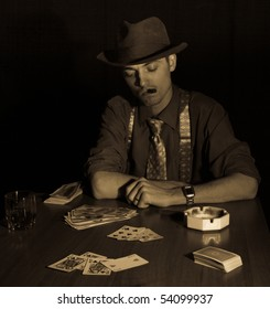 old style photo of man playing card game and smoking cigar