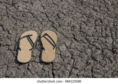 7d809d946dcc20 Old Style Sandals on Dried Cracked Ground