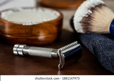 Old style men's shaving accessories, safety and straight razors, brush and shaving soap, for home use.