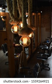 old style spotlights in interior with black chairs