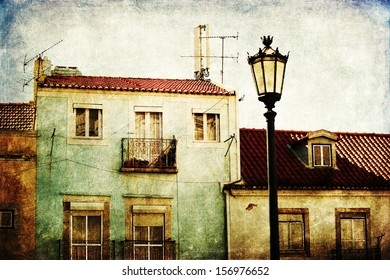 old style textured picture of old houses in Lisbon, Portugal