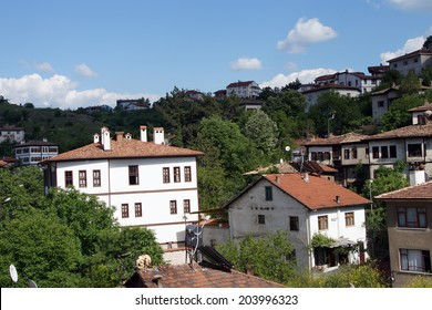 Old style Turkish konak country houses on a tree covered hillside  in  Safranbolu, Turkey
