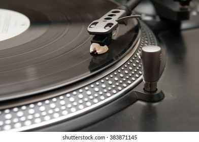 Old style vinyl record spinning on a turntable