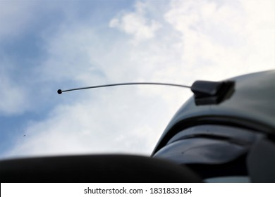 Old styled car antenna with clear blue skies