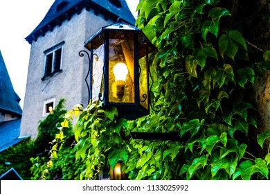 Old styled lantern on overgrown castle wall