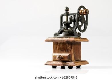 Old stylish coffee grinder on white isolated background