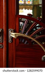 Old stylish wooden door with nice brass doorknob