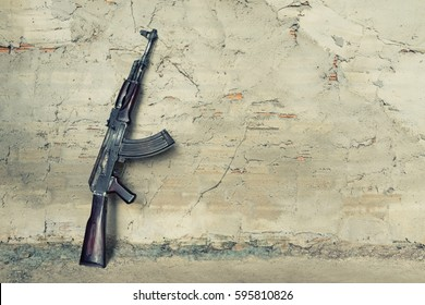 old submachine gun  kalashnikov  AK-47 against the wall