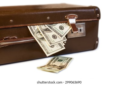 old suitcase full of money. shabby brown retro suitcase with world currencies