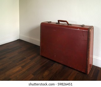 Old Suitcase on wood floor and white wall