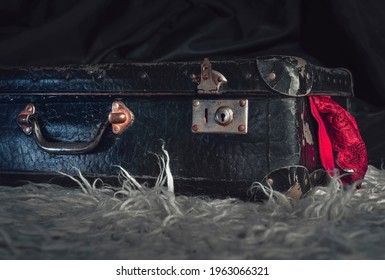 old suitcase with red panties