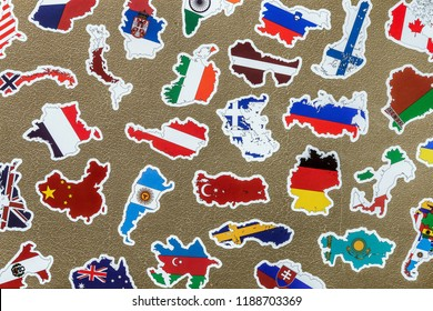 old suitcase with stickers of flags of the of traveling around. background