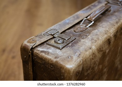 old suitcase vintage close up photo with blurry background
