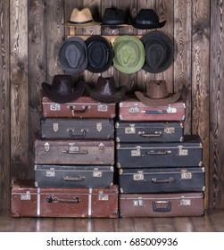 Old suitcases and men's hats