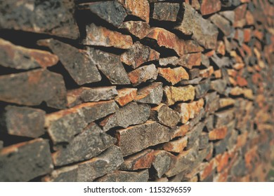 Old sunburnt brick wall from left perspective view