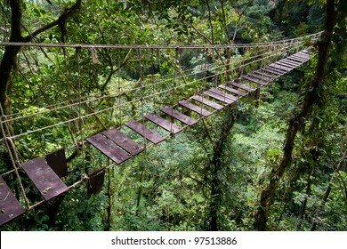 Old suspension bridge in rainforest of Costa Rica