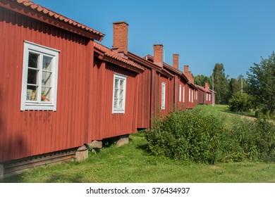 Old swedish cabins near a church