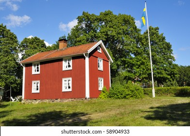 An old Swedish House painted with the Typical Swedish red copper based paint.