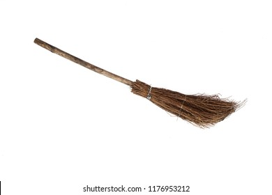 old sweeping broom , white background
