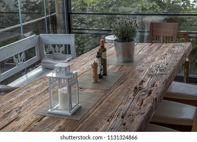 Old table from oakwood with candle lantern and spices