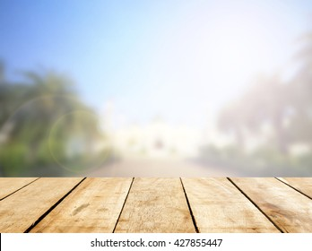 Old Table wooden bar with beautiful mosque background. Nobody planks desk in fade mubarak wallpaper concept - ramadan product mockup, Outside beach sunset sky in summer scene backdrop.
