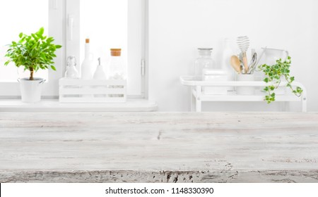 Old tabletop for product display over defocused vintage kitchen background