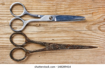 old tailor scissors  on the wooden background