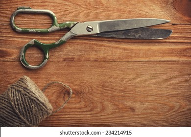 Old tailors scissors on wood background