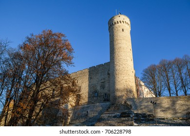 Old Tallinn castle tower with wall. Sunny day.