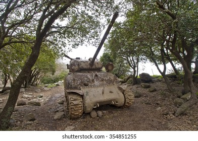 an Old tank placed in a forest at the Golan Heights, Israel.
