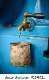Old tap with rusty mug - water supply shortage